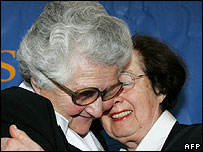 Holocaust survivor Miriam Schmetterling (left) embraces Jozefa Czekaj-Tracz, who saved her life