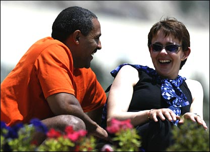 Daley Thompson and Tanni Grey-Thompson share a joke in 2002