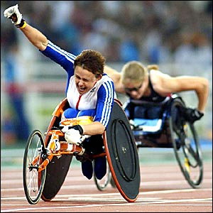 Tanni Grey-Thompson finishes in first place in the women's T53 100m in Athens