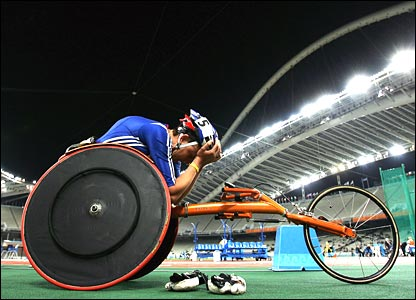 Tanni Grey-Thompson holds her head in despair after finishing fifth in the women's 800m T53 final in Athens