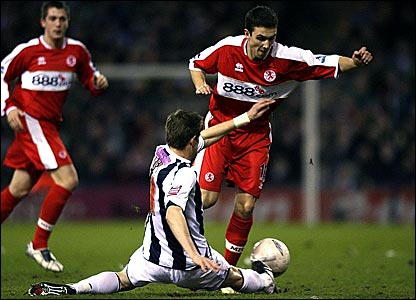 West Brom's Zoltan Gera (foreground) tackles Middlesbrough's Stewart Downing