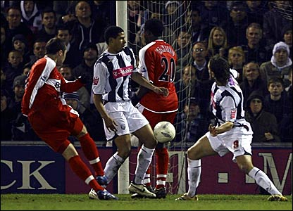 Mark Viduka (left) scores for Middlesbrough
