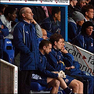 Reading boss Steve Coppell (left) watches the action