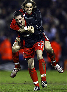 Jonathan Woodgate (top) and Andrew Taylor celebrate Middlesbrough's FA Cup win at West Brom