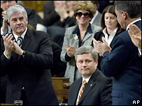 Conservatives applaud PM Stephen Harper after vote