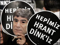 "Cut-out portrait of Hrant Dink with words ""We are all Hrant Dink"" in Turkish"