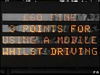 Road sign warning of new mobile phone laws 