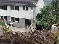 A house whose garden has collapsed into a former mine