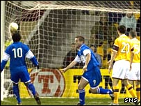 Peter MacDonald wheels away after scoring the opening goal