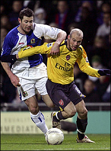 Blackburn's Brett Emerton (left) tussles for the ball with Freddie Ljungberg