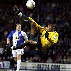 Arsenal's Julio Baptista attempts a spectacular shot on the Blackburn goal