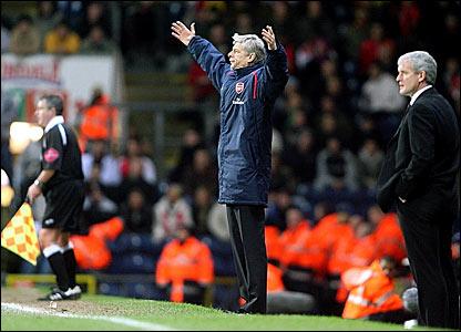 Arsenal boss Arsene Wenger (left) and his Blackburn counterpart Mark Hughes