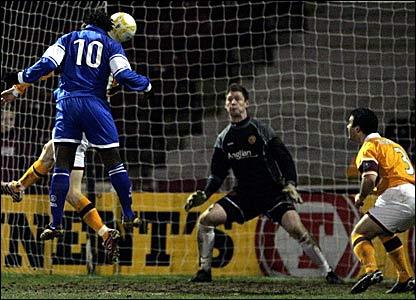 Jason Scotland (number 10) scores Saint Johnstone's second goal