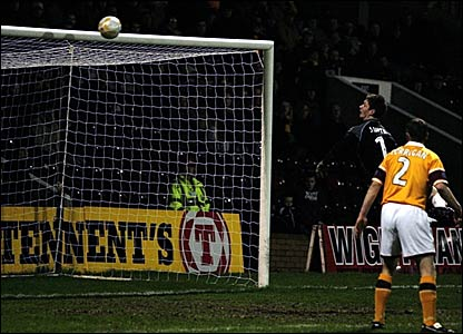 Motherwell keeper Graeme Smith can only watch as Peter MacDonald's shot loops over him