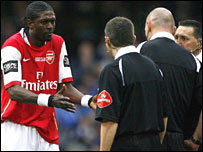 Emmanuel Adebayor protests after his red card in the Carling Cup final
