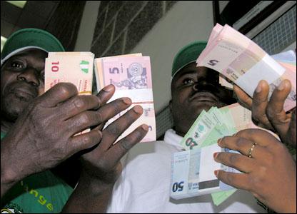 People holding new naira notes: 50, 20, 10 and 5 naira denominations
