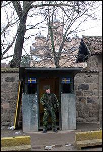 Swedish K-For soldier guards the historic Serb church in Gracanica, near Pristina