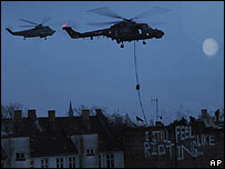 Danish police helicopters launch an eviction operation in Copenhagen