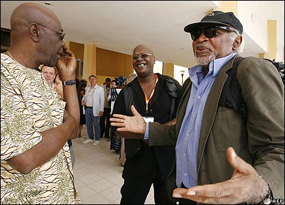 Congolese director Gerald Esomba (R) chats with honorary film festival president, Franco-Cameroonian musician Manu Dibango (L), in Ouagadougou before the opening ceremony of Fespaco