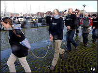 Campaigners bound in chains start their walk