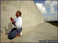 Woman praying. Image: Getty