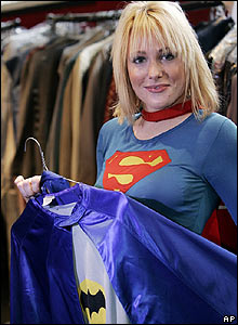 Supergirl model holding Batman costume