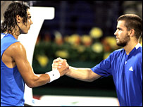 Rafael Nadal (left) shakes hands with Mikhail Youzhny after his defeat