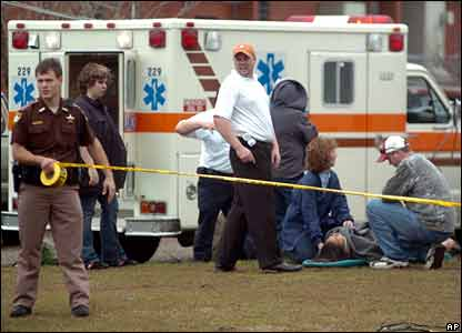 Medics treat an injured person outside Enterprise High School, AL