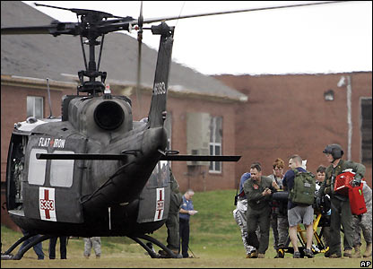 Wounded person is taken to military helicopter