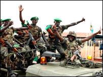 Ugandan troops wave