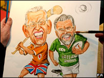 Artist Ray Sherlock puts the finishing touches to a political caricature of Gerry Adams and Ian Paisley