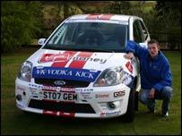 Elfyn Evans with is Fiesta car