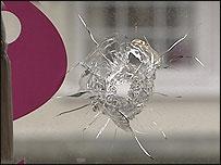 Bullet through window