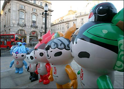 The five official mascots for the 2008 Olympic Games visit Piccadilly Circus