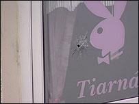 Bullet hole in window