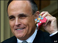 Rudy Giuliani displays his honorary KBE after receiving it from Queen Elizabeth