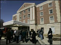 Reporters gather at the premises of the Walter Reed Army Medical Center. File photo