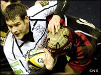 Ospreys wing Jonny Vaughton is tackled by Alasdair Strokosch