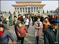 People walk away from Mao Zedong's mausoleum