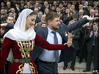 Kadyrov dances with woman in traditional costume during Friday's celebrations