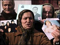 Relatives of disappeared hold photos
