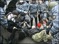 Riot police detain a demonstrator during a protest in St. Petersburg, 3-3-07.