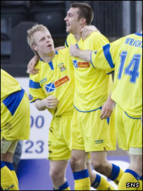 Nish (right) celebrates with strike partner Steven Naismith