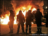 Police by a burning barricade in Copenhagen