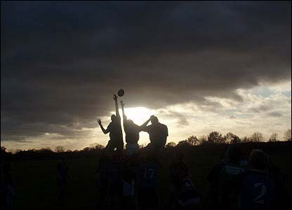 Andrew Finn sent us this picture, taken by Daniel Bosher, of him being lifted into the setting sun while playing for Roehampton University at Brunel University