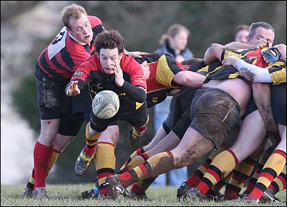 Glen Rogers' photograph manages to freeze the Saltash scrum-half in mid air