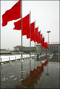 Row of red flags flutter outside the Great Hall of the People