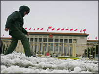 Soldier picks his way through the snow in Tiananmen Square