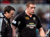 Phil Vickery is helped off with suspected concussion