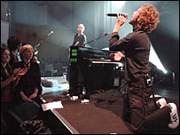 Coldplay performing at Abbey Road Studios in London